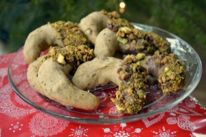 25 Days of Christmas Cookies: Day 5 - Chocolate Dipped Pistachio Crescents are a small nod to a simpler time. Buttery crescents that melt in your mouth, dipped in rich chocolate and covered in nuts. It doesn't get much better than that.