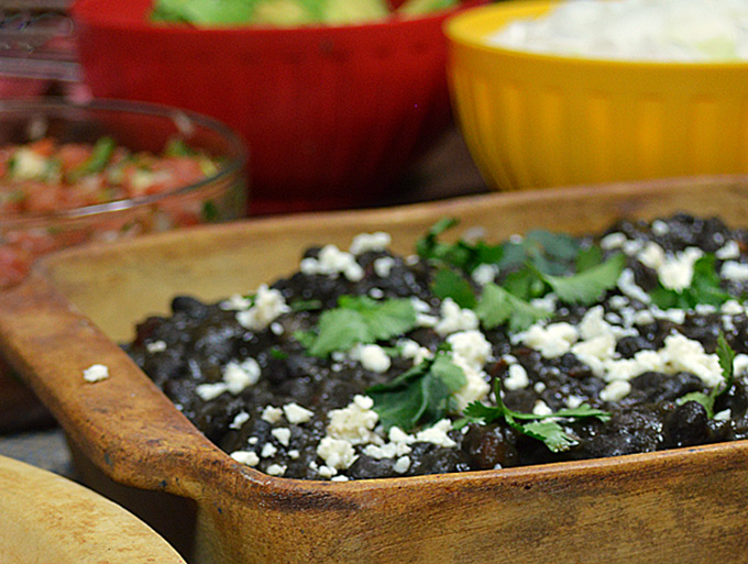 Frijoles Negros (Black Beans) and Modelo: Black beans, slowly simmered with Negro Modelo and chipotle, gives an extra punch of flavor to an already favorite.