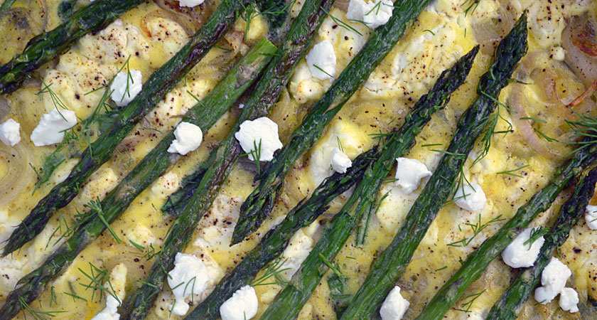 Spring Quiche: Fresh spinach, shallots, goat cheese and roasted asparagus. The combination of fresh vegetables with a tangy salty bite of  goat cheese is out of this world.